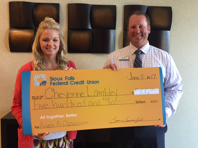 Joey Rotert, Marketing and Business Development Manager presents Mount Marty College alumna and first-grade teacher at Tri-Valley Elementary School in Colton, South Dakota, Cheyenne Lambley, one of six Sioux Falls Federal Credit Union 2017 Adopt a Classroom Grants.