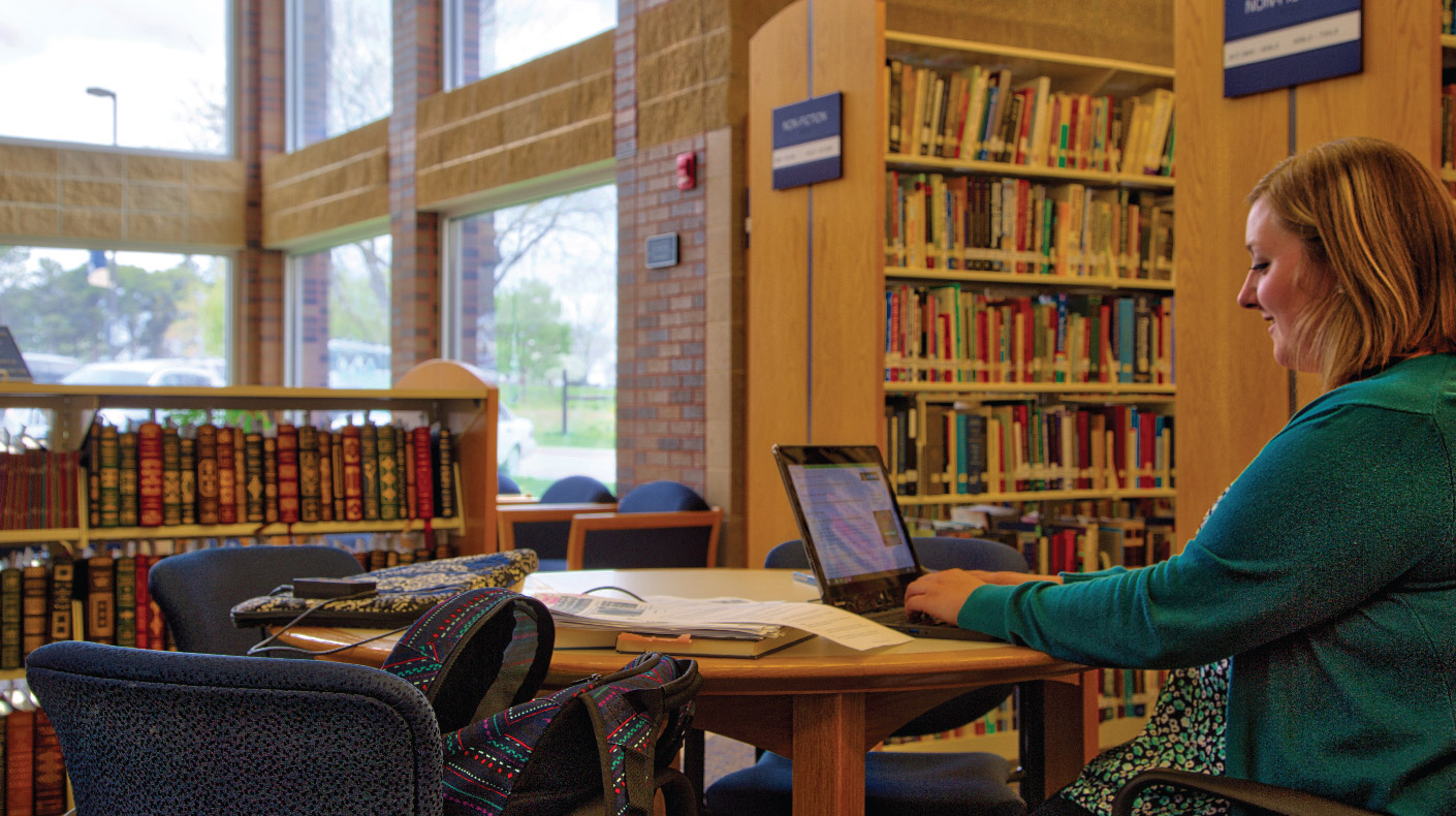 Mount Marty Student in Library